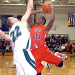 Elyria's #23 Ronnie Smith tries to shoot past Westlake's #22 Shawn Turk.