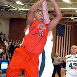 Elyria's #5 Dontae Dukes tries to shoot past Westlake's #44 Gavin Skelly.