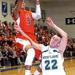 Elyria's #10 Isaiah Walton tries to shoot past Westlake's #22 Shawn Turk.