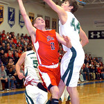 Elyria's #2 Kody Bender tries to shoot past Westlake's #44 Gavin Skelly.