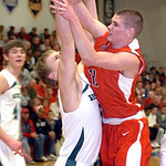 Elyria's #2 Kody Bender fights Westlake's #5 Connor Meek for the ball.