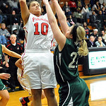 Elyria Shayla Middlebrooks shoots over Westlake Kelly Laraway in overtime of Div. I sectional Feb. 20. Steve Manheim