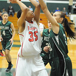Elyria ALexis Middlebrooks shot over Westlake Monica Fury in first half Feb. 20. Steve Manheim