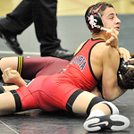 Armando Torres of Elyria pins Strongsville's Justin Kahwaji in the first period. DAVID RICHARD / CHRONICLE