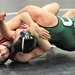 Elyria's Taylor Workman, left, works against Nick DiSalvo of Strongsville in a 170-pound match. DAVID RICHARD / CHRONICLE