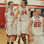 Firelands 30 Casey Smith, 34 Joseph Hyster and 22 Cole Sklarek celebrate PAC stripes division title win on Feb. 19.  Steve Manheim