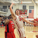 Firelands Joseph Hyster puts in the game winner past Brookside Nathan Keith for the PAC Stars division titile on Feb. 19.  Steve Manheim