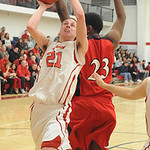 Firelands Logan Sittinger puts in shot over Brookside Nathan Keith Feb. 19.  Steve Manheim