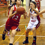 Firelands #12 Alyssa Melendez goes up for a basket past Lutheran West's #1 Bre Coreno.