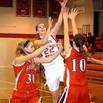 Firelands' #22 Rachel Holowecky shoots past Lutheran West's #30 Abby DeSimpelare and #10 Marissa Nuti.
