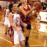 Firelands' #22 Rachel Holowecky leaps up for a basket past Lutheran West's #22 Lindsay Thomas.