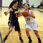 Vermilion's Ali Kowal gets set for a shot over Avon's Jessica Yurkovich. STEVE MANHEIM/CHRONICLE