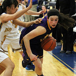 ANNA NORRIS/CHRONICLE<br /> Avon&#039;s Mackenzie Meckes drives around Wooster&#039;s Tirzah Talampas in the second half of the Division I district semi-final game at Valley Forge High School Monday night.