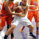 Vermilion's Jen Kovarik and Edison's Chelsea Imus fight for a rebound. STEVE MANHEIM/CHRONICLE