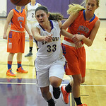 Vermilion's Ali Kowal knocks ball out of bounds as Edison's Liz Hill watches. STEVE MANHEIM/CHRONICLE