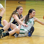 Columbia's Becca Tacchite, right, tries to control the ball Wednesday during the Raiders' Division IV sectional victory over Hillsdale. STEVE MANHEIM/CHRONICLE