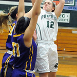Elyria Catholic's Riley Schill is guarded by Avon's Sierra Davidson, front, and Sarah Sprecher. STEVE MANHEIM/CHRONICLE