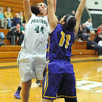 Elyria Catholic's Jessie Lee shoots over Avon's Sierra Davidson. STEVE MANHEIM/CHRONICLE
