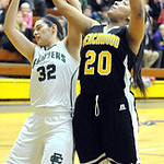Beachwood's Jade Stevens knocks the ball away from Elyria Catholic's Becky Horvath. STEVE MANHEIM/CHRONICLE