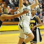 Elyria Catholic's Riley Schill drives past Beachwood's Jade Stevens, left, in the first half. STEVE MANHEIM/CHRONICLE