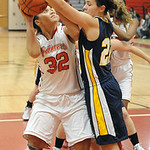 Elyria's Sierra White shoots over North Ridgeville's Isabella Pecchia. STEVE MANHEIM/CHRONICLE