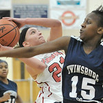 Elyria's Samantha Jarjar, left, drives to the basket against Brianna Williams of Twinsburg. DAVID RICHARD / CHRONICLE