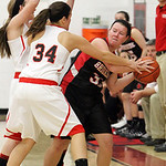 ANNA NORRIS/CHRONICLE<br /> Brookside&#039;s Marissa Bias looks for the open man around Firelands&#039; Heather Smyth (34) and Haleigh Bari (30) in the first half Monday night at Firelands High School.