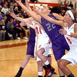Keystone's Darcy Irish fights Fairview's Megan Coyne and Bri Kovacevich for the rebound. LINDA MURPHY/CHRONICLE