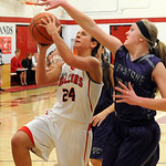Firelands' Brandi Holowecky drives past Keystone's McKenah Peters.  STEVE MANHEIM/CHRONICLE