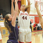 Firelands' Keely Hall shoots over Keystone's Jillian Peters.  STEVE MANHEIM/CHRONICLE