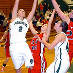 Elyria Catholic's Julia Scarpelli shoots past Lutheran West's Lydia Hessler. LINDA MURPHY/CHRONICLE