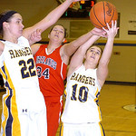 North Ridgeville's Isabella Pecchia, left, and Kelly Wisniewski fight Firelands' Heather Smyth for the rebound. LINDA MUPRHY/CHRONICLE
