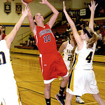 Firelands' Cassandra Morrissette shoots past North Ridgeville's Sami Shaw. LINDA MUPRHY/CHRONICLE