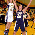 Olmsted Falls' Hannah Hammeren shoots past North Ridgeville's Isabella Pecchia. LINDA MURPHY/CHRONICLE