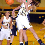Olmsted Falls' Hannah Hammeren and North Ridgeville's Isabella Pecchia fight for the rebound. LINDA MURPHY/CHRONICLE
