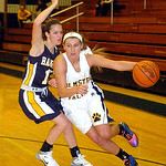 Olmsted Falls' Kerri Gasper works her way around North Ridgeville's Leah Lindak. LINDA MURPHY/CHRONICLE