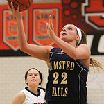 ANNA NORRIS/CHRONICLE<br/>Olmsted Falls&#039; Kerri Gasper goes up for the basket against North Olmsted in the second half Saturday afternoon at North Olmsted High School.