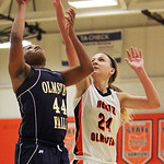 ANNA NORRIS/CHRONICLE<br/>Olmsted Falls&#039; Savanajh Black puts up a basket over North Olmsted&#039;s Molly Dailey in the second half Saturday afternoon at North Olmsted High School.