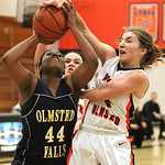 ANNA NORRIS/CHRONICLE<br /> Olmsted Falls&#039; Savanajh Black goes up for the layup as North Olmsted&#039;s Sarah Lyons gets a hand on the ball in the fourth quarter Saturday afternoon at North Olmsted Hig &#8230;