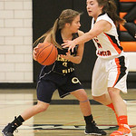 ANNA NORRIS/CHRONICLE<br/>North Olmsted&#039;s Sarah Lyons reaches in on Olmsted Falls&#039; Erica Coley in the first half Saturday afternoon at North Olmsted High School.