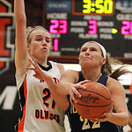 ANNA NORRIS/CHRONICLE<br/>Olmsted Falls&#039; Kerri Gasper drives to the basket against North Olmsted&#039;s Stephanie Kemp in the second half Saturday afternoon at North Olmsted High School.
