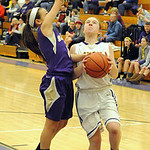 Avon's Alyssa Douzos puts up a shot over Vermilion's Jessica Mello. STEVE MANHEIM/CHRONICLE