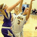 Avon's Jessica Yurkovich has the ball knocked away by Vermilion's Jen Kovarik. STEVE MANHEIM/CHRONICLE
