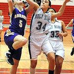 Vermilion's Sarah Bartlome is fouled by Holy Name's Jackie Corrigan. STEVE MANHEIM/CHRONICLE