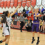 Vermilion's Caitlyn Schnur hits a shot over Holy Name's Kim Cook.  STEVE MANHEIM/CHRONICLE