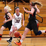 Wellington's Karly Rollin dribbles between Buckeye defenders Maggie Calame, left, and Alexa Eisenbrown.  AARON JOSEFCZYK / CHRONICLE