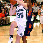 Westlake's Erin O'Neill drives around Berea-Midpark's Stasha Carey. LINDA MURPHY/CHRONICLE