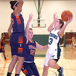 Westlake's Rebecca Essig shoots past Berea-Midpark's Stasha Carey, left, and Tiana Moody. LINDA MURPHY/CHRONICLE