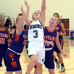 Westlake's Rebecca Essig shoots past Berea-Midpark's Tiana Moody, left, and Jess Barnes. LINDA MURPHY/CHRONICLE