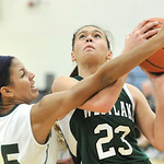 Westlake's Monica Fury, right, drives to the basket against Monica Eckford of Lake Catholic. DAVID RICHARD / CHRONICLE